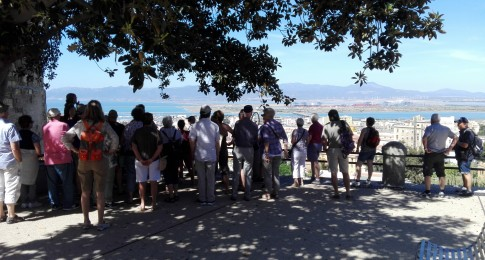 A group of tourists admiring the beauty of the Golfo degli Angeli
